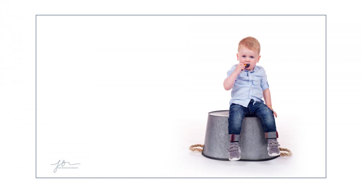 Toddler sitting on a bath tub